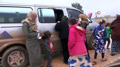 ambulans soforu -  - İdlib'den kaçarak kampa sığınan siviller çadır hastanesinde tedavi oluyor