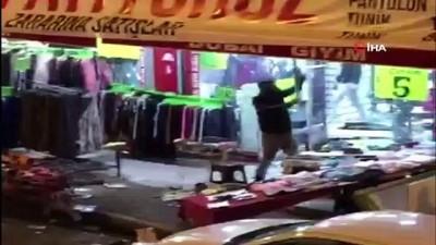 Ellerindeki demir çubuklarla mağazayı talan eden şahıslar kamerada