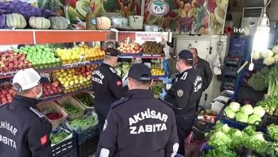 Akhisar'da market, ganyan ve kargo işletmeleri denetlendi