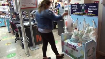 supermarket -  Askıda gıda kampanyası yardıma muhtaçların umudu oldu