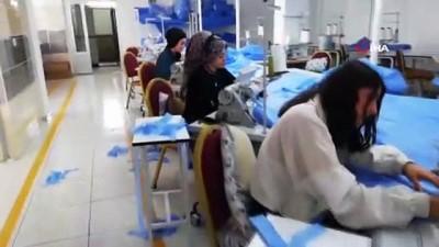 tekstil fabrikasi -  Varto Belediyesi'ne tulum ve maske desteği