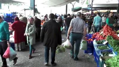 yagisli hava - Vatandaşlar bayram öncesi mezar ziyareti ve alışveriş yaptı - KARABÜK