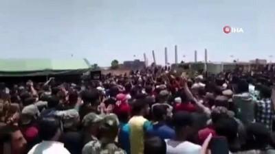 - Rejim askerlerinin cenaze töreninde Esad ve İran karşıtı gösteri