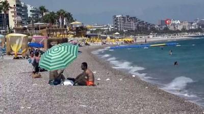 yabanci turist -  Dünyaca ünlü sahil tatilcilere kaldı