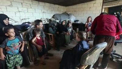 İdlib'de gönüllü kuaförler bayram öncesi çocukları sevindirdi