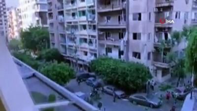 saglik gorevlisi -  - Lübnan'daki cami ve hastanede büyük hasar - Patlama anı alışveriş merkezinin kamerasına yansıdı