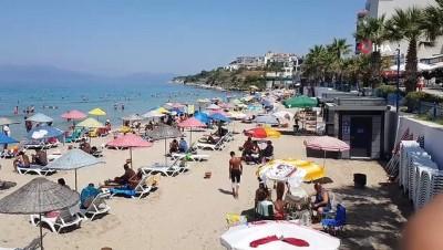 kamu gorevlileri -  Kuşadası plajları denetimden tam not aldı