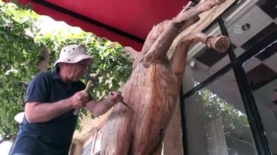 'Güzel atlar ülkesi'ni ağaç ve taş heykellerle tanıtıyor - NEVŞEHİR