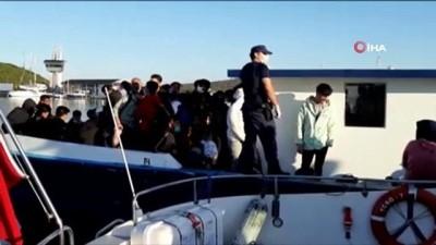 İzmir'de yurt dışına geçmeye çalışan tekneye baskın: Çok sayıda kişi yakalandı