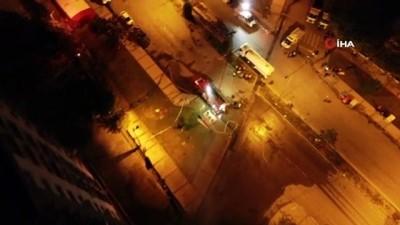supermarket -  3 vinçle ayakta tutulan Yılmaz Erbek Apartmanında yıkım sürüyor