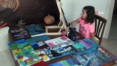 ilkokul ogrencisi -  Kendi ormanını kurmak için hayallerini tuvale yansıtıyor