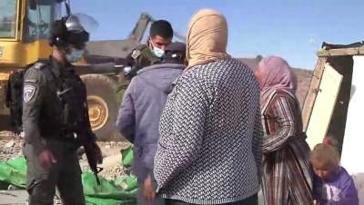 irak - EL HALİL - İsrail güçleri Batı Şeria'da 4 Filistinli aileyi evsiz bıraktı