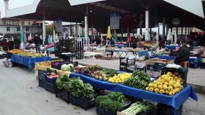 BURDUR - Karantinada olması gereken 10 kişi semt pazarında yakalandı