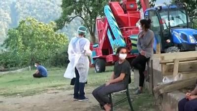 saglik taramasi -  Fındık işçileri bahçeye girmeden sağlık taramasından geçti