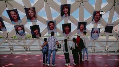 portre -  - Kazakistan'da salgınla mücadele eden sağlıkçıların portreleri üst geçide asıldı