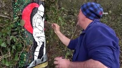 Ağaç üzerine çizdiği 3 boyutlu resimler dikkat çekiyor