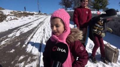 Çocukların leğenli, naylonlu kar keyfi