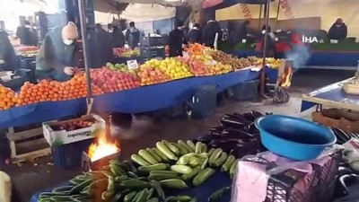 pazarci esnafi -  Kütahyalı pazarcılar tenekede ateş yakarak ısınıyor