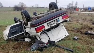 Kontrolden çıkan araç takla atıp tarım arazisine devrildi