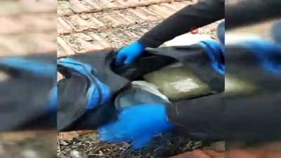 Çatıya atılan çantadan 2 kilo bonzai çıktı