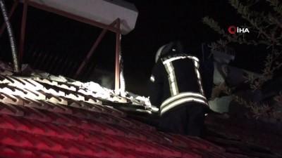 Odunlukta çıkan yangın eve sıçramadan söndürüldü