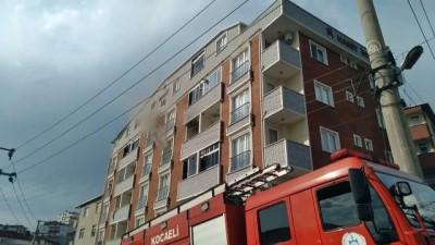 itfaiye merdiveni - KOCAELİ - Bir apartmanda çıkan yangın söndürüldü