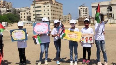 psikoloji - GAZZE - Gazzeli çocuklar İsrail saldırılarında ölen arkadaşlarının resimlerini uçurtmalarla gökyüzüne bıraktı