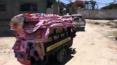 yazili aciklama - GAZZE - TİKA'nın Gazze Şeridi'ne yardımları sürüyor
