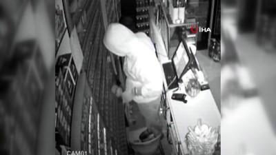Hırsızlık yaptığı yerlere iz bırakmamak için gazlı içecek döktü...O anlar kamerada