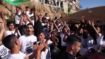 KUDÜS -İsrail'in, 'zorla yerinden etme' politikasına karşı düzenlenen maratona müdahalesinde 23 Filistinli yaralandı