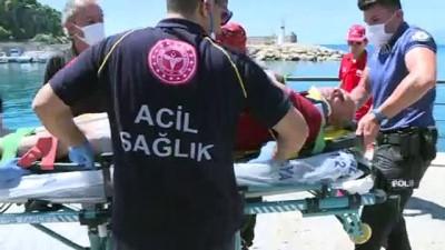 ANTALYA - Güneşlenirken cankurtaran kulesi üzerine devrilen tatilci yaralandı