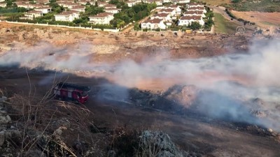 ANTALYA - Dağlık alanda çıkan yangın söndürüldü