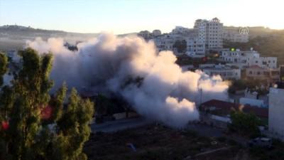 goz yasartici gaz - RAMALLAH - İsrail, Batı Şeria'da Filistinli bir tutuklunun evini yıktı