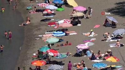gurultu -  Hava sıcaklığı 32 dereceye ulaştı, vatandaşlar plaja akın etti
