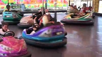 isaf -  Çocuklara lunaparkta ücretsiz eğlence