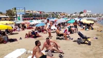 turist -  Artan korona virüs vakalarına rağmen Altınkum Plajı tıklım tıklım