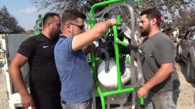 a haber -  Yangında zarar gören hayvan sahiplerine ücretsiz süt sağma makinesi dağıtıyorlar